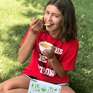Girl in Red Shirt with Kids Cooking Box